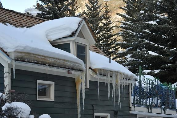 This photo shows a classic ice dam formation. Pooled snowmelt behind this ice dam will eventually leak into the structure and might not be detected for years. Once the leak is detected, mold (sometimes toxic mold), mildew, structural rot will be the result and all the associated repair costs. Lastly, the roof will need to be replaced sooner than if an effective roof ice dam prevention system had been installed, i.e. the HotEdge Rail.