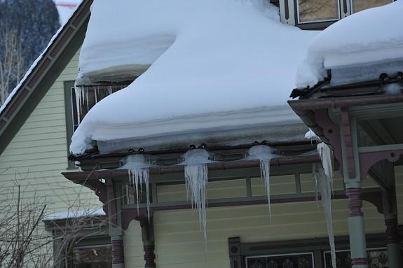 Clearly this photo shows how ice dams, ice balls, and icicles can develop using zig zag heat tape on a roof edge. Not only is the owner not getting a desired (preventing ice dams and icicles from forming), the owner is paying energy bills that are up to 70% more than they need to be and they have to look at heat tape on their roof year-round. In short, the revolutionary HotEdge Rail represents more effective, lower cost solution.