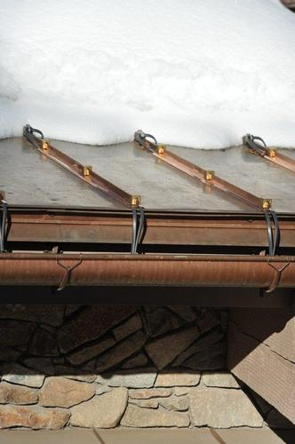 Many customers are interested in a melt line that would exceed what the HotEdge Rail is able to accomplish from the drip edge. On this project, HotSeam is able to create a melt line 4+ feet up from the drip edge on this standing seam metal roof. Hot Seam is attached to the standing seam using clamps to press heat tape firmly against the metal panel resulting in heat transfer that extends from seam to seam. It is possible to keep an entire problematic area on a standing seam metal roof structure free of snowpack and ice with the HotSeam product.