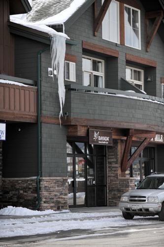This photo shows the liability risks of icicles hanging off the edge of a commercial building in high snow load country. Solution: HotEdge Roof Ice Melt System makes it virtually impossible for icicles to develop on a warm roof edge. The HotEdge Roof Ice Melt System is a direct transfer of heat from a commercial grade self-regulating heat cable to any roof edge.