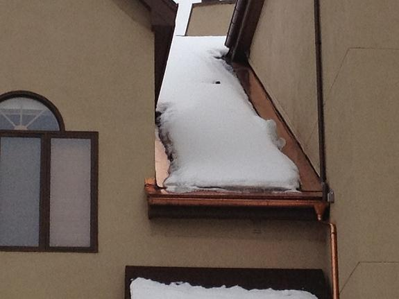 As you can see in this photo, HotFlashing was installed where the wall meets the roof deck. This is typically a very problematic region on a roof structure in high and medium snow load areas. With HotFlashing and one single run of heat cable all ice build-up has been prevented to avoid property damage.