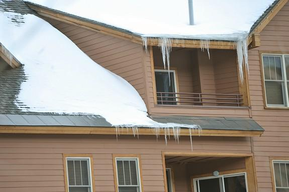 "This photo points out an important fact. The costly extruded aluminum metal track system shown in the photo does not appear to be performing. Ice dam formations are on the roof edge. We know the system can work. The problem appears to be that it is not being powered properly, i.e. it is not powered on at least 8 hours before a storm arrives or it is powered off at a time of day giving snowmelt a chance to refreeze at night, etc. If a HotEdge system was not powered properly it would appear to not appear to be performing also. IT IS CRITICAL WITH A extruded aluminum metal track systems OR A HOTEDGE SYSTEM TO POWER IT PROPERLY TO PREVENT ICE DAM AND ICICLE FORMATIONS! Again, the chief difference between the extruded aluminum metal track system and the HOTEDGE system is cost; purchase, operate, and maintain. Both systems are designed to accomplish the same result; prevent ice dam and icicle formations on roof edges. Both systems are designed to hold heat cable. Period. The extruded aluminum metal track system requires 2-3 heat cables because of its complexity. The HotEdge Rail requires 1 heat cable because if its simplicity. The HotEdge Rail represents a ""better mousetrap"", hence, the extruded aluminum metal track system is at risk of becoming obsolete."