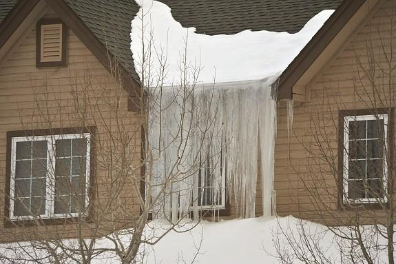As you can see in this photo, you do not have to have two feet of snowpack on your roof to have serious icicle problems. Icicles are a large property and safety risk. Although there is not a walk-way, entry way, driveway, air conditioner compressor, patio furniture below icicles in this photo there are windows. It is probable that if the icicles break off before they melt away slowly that they will fall back into the windows and cause damage to the windows, possibly the frames and property inside. The only way to prevent icicles is to heat the roof edge. If you have a gutter system it will also be necessary to lay heat cable in the gutter trough also. Again, the key to any effective roof ice prevention system is to take snowmelt to the ground before it ever has the chance to re-freeze!