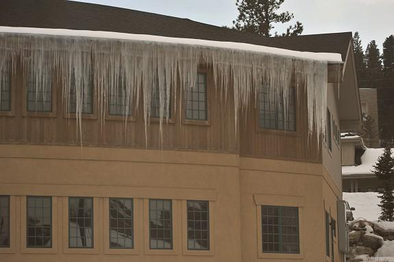 The right combination of freeze/thaw cycles can create massive and dangerous icicles! Most of this roof structure does not even have snowpack, however, between mother nature and heat loss from the structure large icicles are possible. These are large enough that they would destroy a gutter system if it existed and it poses a safety and property risks to anything below.
